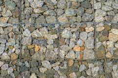 Stone walls prevent landslides in country road. Stock Photos