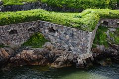 Stone walls of Suomenlinna fortress on the shore of the Baltic S Royalty Free Stock Photo