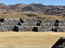 Inca stone walls of the citadel at Saqsaywaman above Cusco, Peru. Stone walls and terraces at the Inca citadel at Saqsaywaman above Cusco with background hills stock image