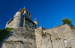 Stone walls and towers of a medieval castle in the town of Provins Stock Photography