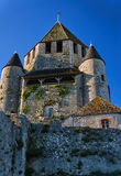 Stone walls and towers of a medieval castle in the town of Provins Stock Images