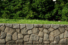 Stone walls and trees. In the parks stock images