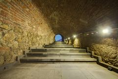 Stone walls tunnel and stairs background Royalty Free Stock Photos