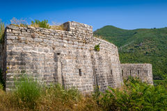 Stone walls of Tvrdava Mogren old fortress in Montenegro Royalty Free Stock Photo