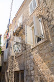 Stone walls and wooden shutters in old Budva, Montenegro stock images