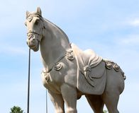 Stone War Horse Statue in Medieval Regalia. Stock Photos