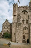 Stone watch-tower, door and walls inside the Gravensteen Castle at Ghent royalty free stock image