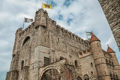 Stone watch-tower, walls and flags inside the Gravensteen Castle at Ghent. royalty free stock photos
