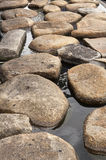 Stone on water Stock Image