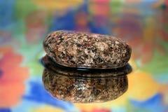 Stone on water Stock Photos