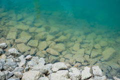 Stone in water at dam Stock Image
