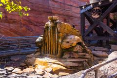Radiator Springs Fountain California Adventure Disneyland. Stone Water feature replica of truck radiator greets visitors who line up to ride the Radiator Springs Royalty Free Stock Image