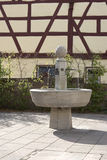 Stone water fountain honoring the former hops farmers of Langenzenn, Germany. Stone water fountain honoring the former growing of hops in the city of Langenzenn Royalty Free Stock Image