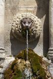 Stone water fountain in Provence Royalty Free Stock Image