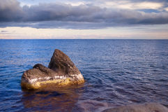 Stone in the water of Issyk-Kul. Lake Stock Photos