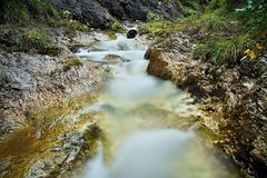 Stone in water in Juran`s valley. Stone in water in Juran`s highland stream in Juran`s valley near the village Zuberec - Oravice, Slovakia royalty free stock images