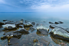 Stone in water Royalty Free Stock Image