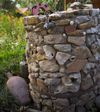 The Stone Water Well. A view from a water well and a tap Royalty Free Stock Images
