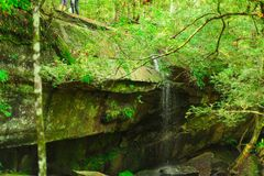 The big stone was borned near the waterfall. stock photos