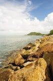 Stone wave barrier near seashore. Royalty Free Stock Photo