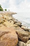 Stone wave barrier near seashore in Thailand. Royalty Free Stock Photo