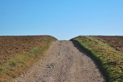 Stony path up the hill. Metaphor for success. Stock Images