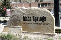 Stone Welcome to Idaho Springs Sign stock photography