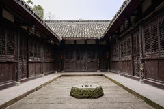 Stone well in courtyard of ancient Chinese dwelling building Stock Photo
