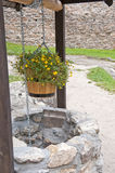 Stone well with flowers Royalty Free Stock Photo