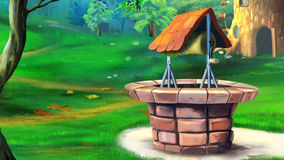 Stone well in the meadow. Royalty Free Stock Image