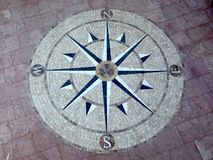 Stone wind rose. Made of limestone and travertine laid out on the floor in an area with instructions to the side of world Stock Photography