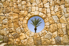 Stone window. With view of palm tree Stock Photo
