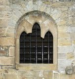 Stone window with bars. In England Stock Images