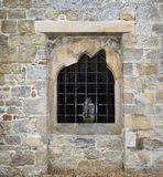 Stone window with bars. In England Royalty Free Stock Image