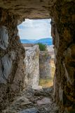 Stone window of a medieval castle. Castilla La Mancha. Spain. View of a medieval landscape through a stone window royalty free stock images