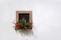 Stone Window with red geranium Royalty Free Stock Photo