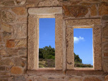 Stone windows. In old mountain home Stock Photos