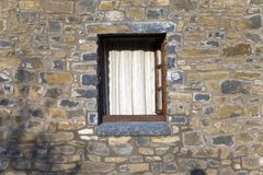 Stone windows of Casa de San Martin Inn, in Aragon, in the Pyrenees Mountains, Province of Huesca, Spain Royalty Free Stock Photo