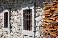 2 stone windows of a chalet stock photos