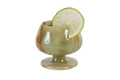 Stone wineglass. With a lime. Isolation on a white background. Clipping path Royalty Free Stock Photos