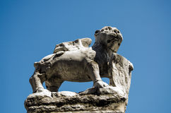 Stone, winged lion, Murano. Weather damaged stone carving of a winged lion, the symbol of Venice.  Island of Murano, Venice, Italy Stock Image