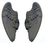 Stone Wings. Stone angel wings on a white background. Stone feathers Stock Photo
