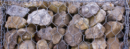 Stone and wire mesh Stock Image