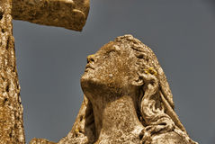 Stone Woman With Cross Royalty Free Stock Photography
