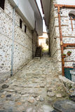 Stone-wood architecture of the town of Melnik, BulgariaThe narrow street in the historic Melnik, Bulgaria Royalty Free Stock Photos