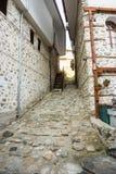 Stone-wood architecture of the town of Melnik, BulgariaThe narrow street in the historic Melnik, Bulgaria Royalty Free Stock Photos