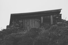 Stone wood shed in hillside from front black and white Stock Photos