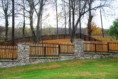 Stone and wooden fence Royalty Free Stock Image