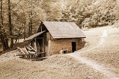 Stone and wooden water mill Royalty Free Stock Image