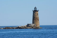 Stone Work. Stone Light House on its own island Stock Photo